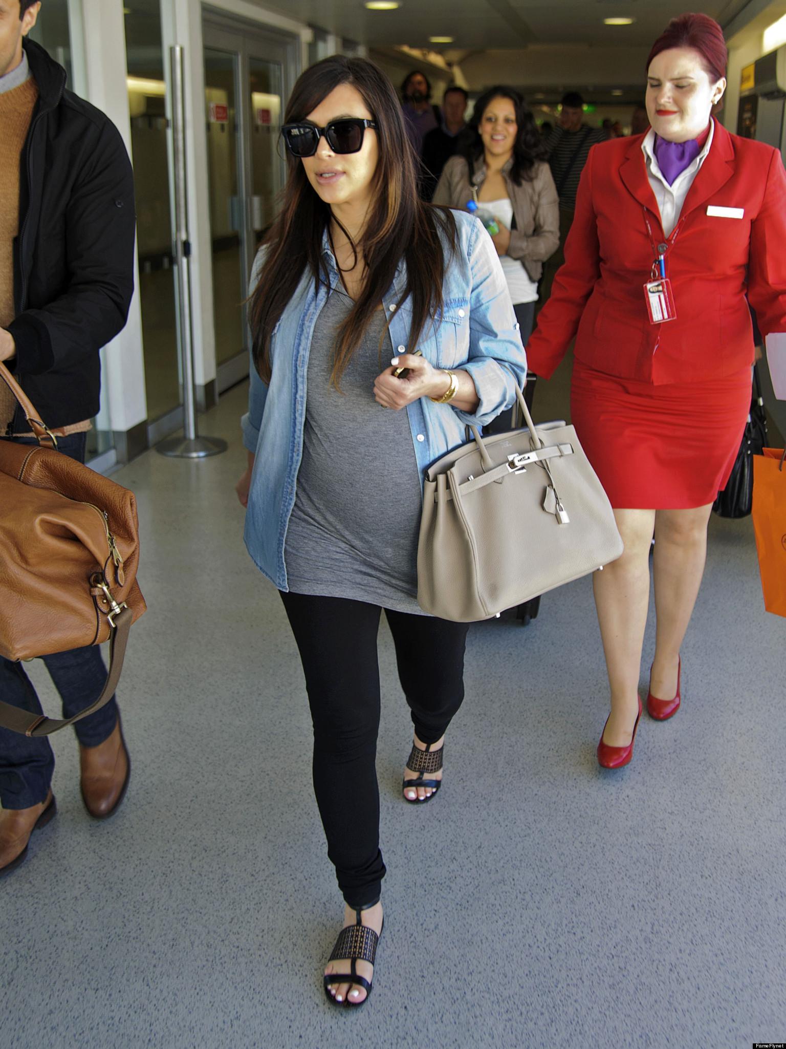 Pregnant Kim Kardashian Makes Her Way Through Heathrow Photo
