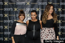 Kim Kardashian Shows Off Her Bump In Leather Panel Dress