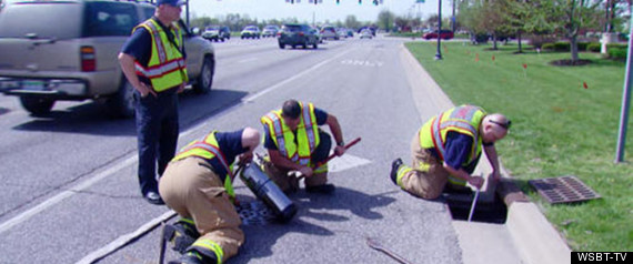 FIREFIGHTERS RESCUE DUCKLINGS