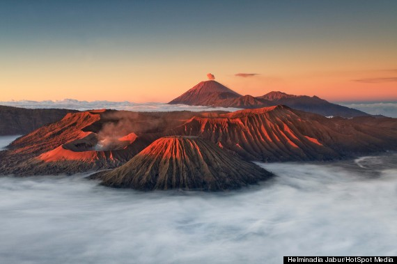 mount bromo billows red smoke