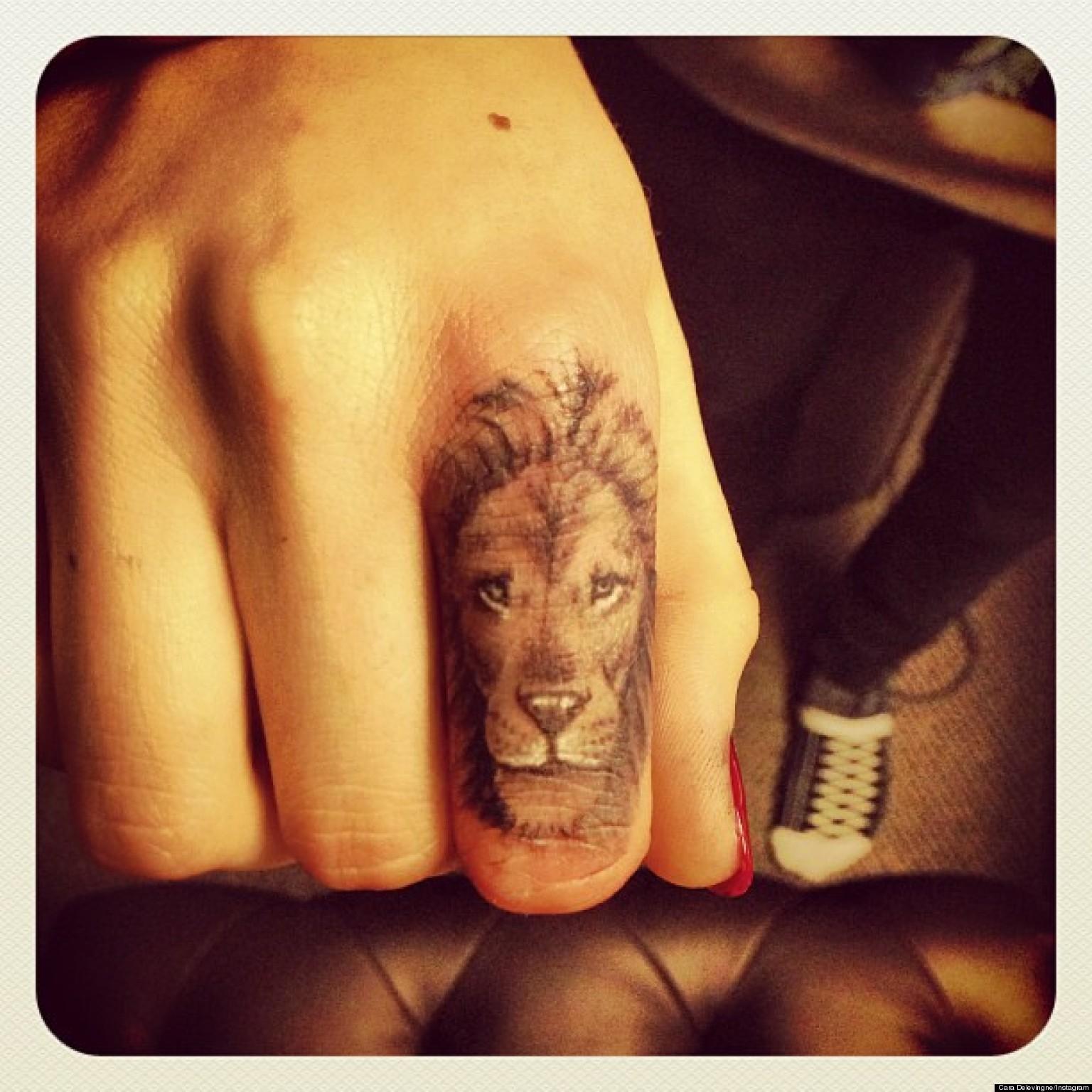 Cara delevingne debuts new lion tattoo on her finger for Finger lion tattoo