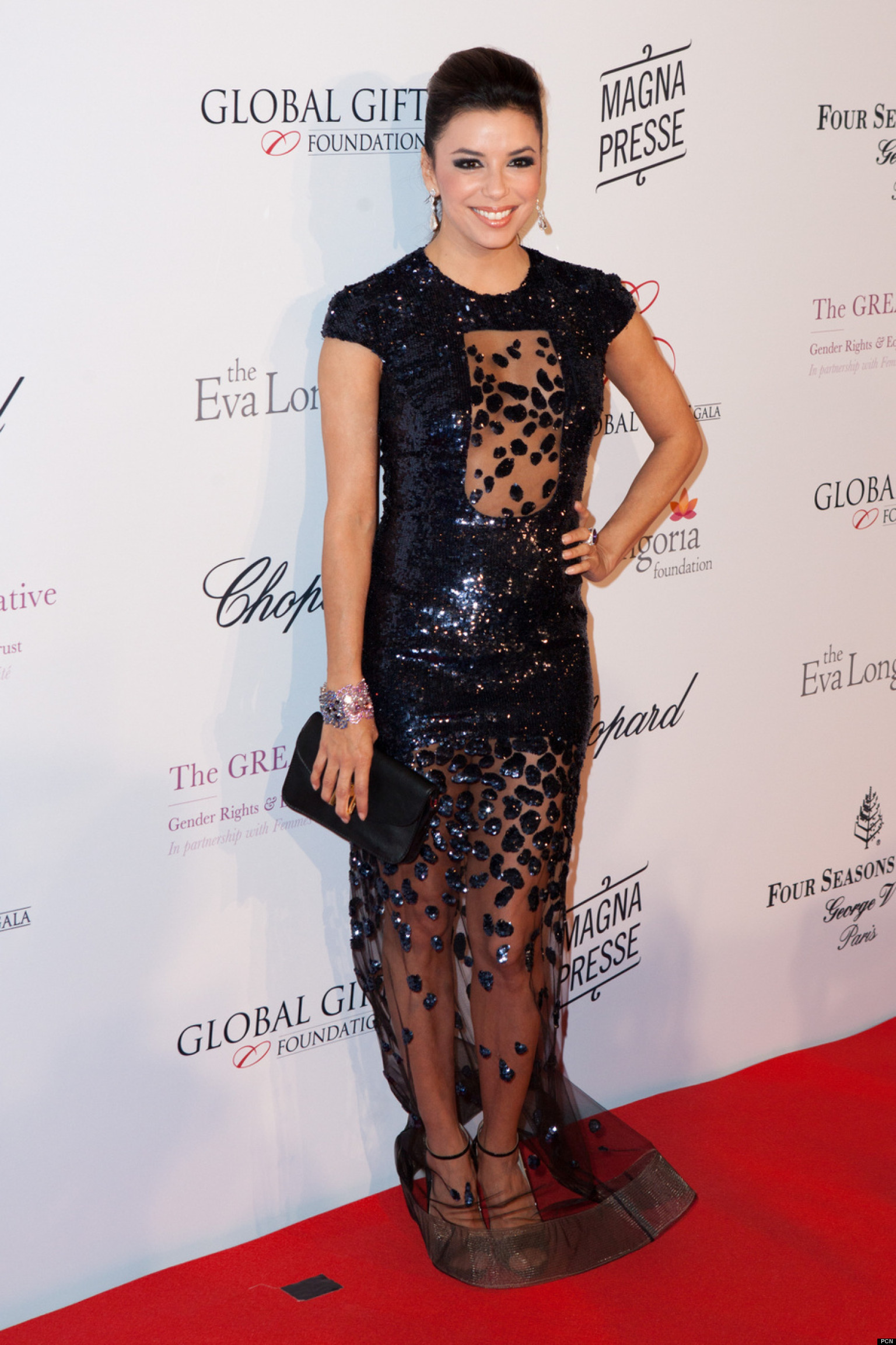 Eva Longoria Shows Odd Bit Of Skin On Red Carpet