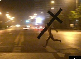 Naked Man Carrying Giant Cross Runs Through Beijing
