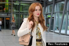 Jet-Setter: Isla Fisher Lands At Heathrow, Still Looks Radiant In Tea Dress And Heels