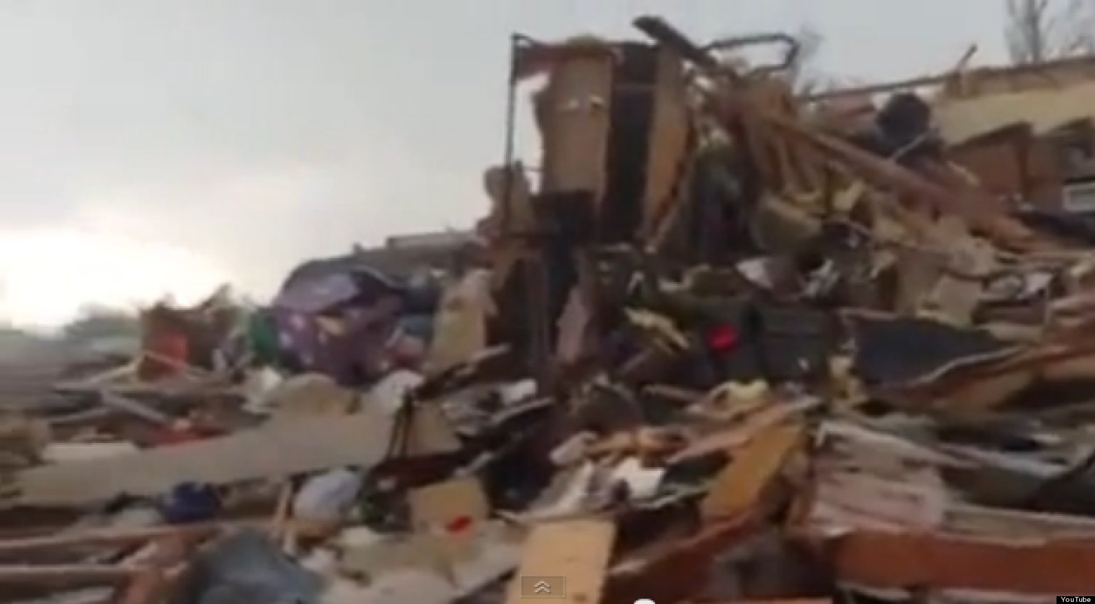 WATCH: Family Emerges From Storm Cellar To Find Neighborhood In Ruins