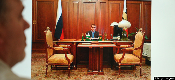 PHOTO: Russian Officer 'Posed At Putin's Desk To Impress Girls'