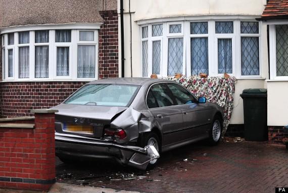 car van smashed house