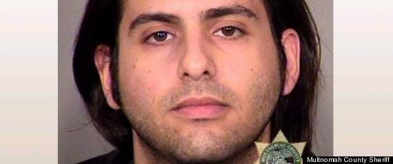 Let me out! Man arrested for trying to open an emergency exit during a flight says he's bipolar (PICTURED)