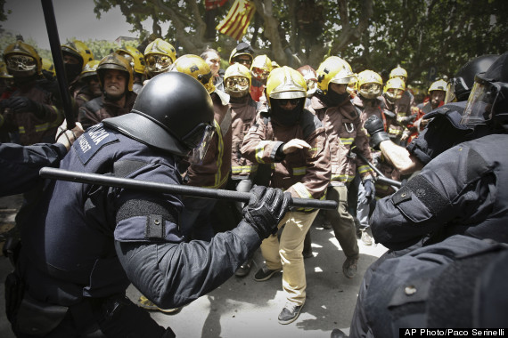 firefighters riot police austerity protest