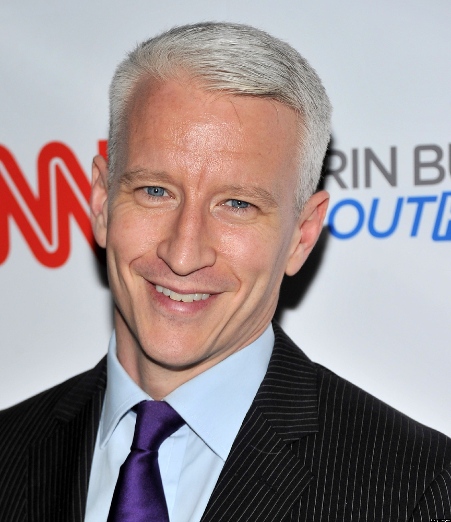 anderson cooper giggling