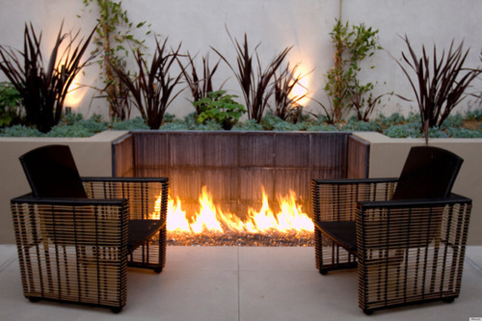 10 Outdoor Fire Pits That Will Take A Backyard From ... on Outdoor Fireplace Pit id=56620