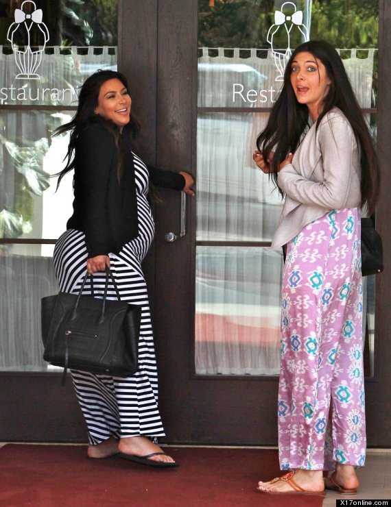 Pregnant Kim Kardashian Shows Baby Bump In Striped Maxi-Dress