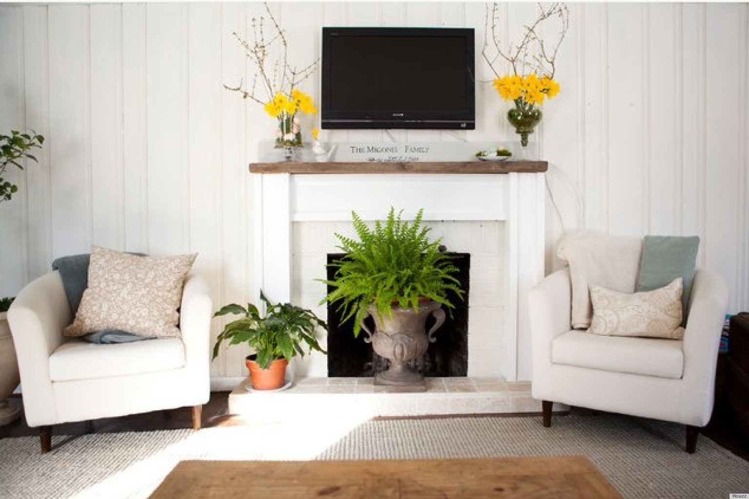 10 ways to decorate your fireplace in the summer since for How to decorate living room with fireplace