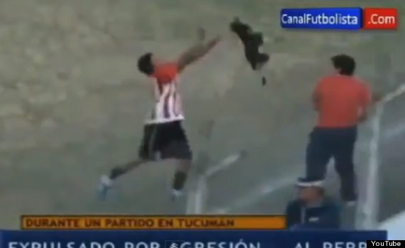 argentinian footballer throws dog off pitch