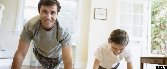 Man Exercising With Son