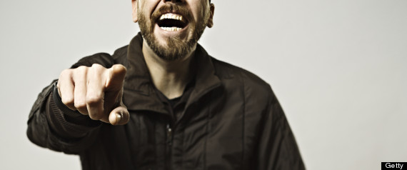 MAN POINTING AND LAUGHING