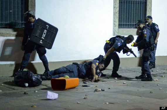 protesters beat police brazil