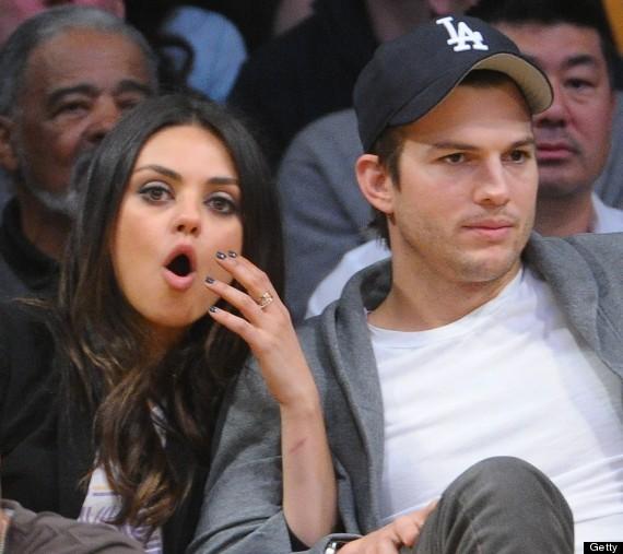 mila kunis ashton kutcher court side