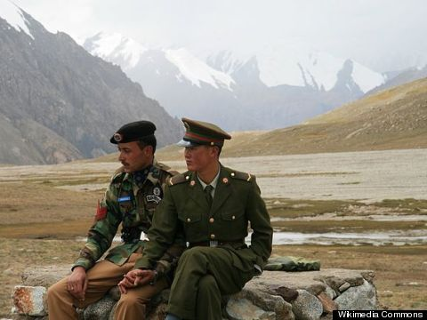 china pakistan guards hold hands