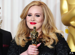 FIRST PICTURES: Adele Shows Off Baby Angelo