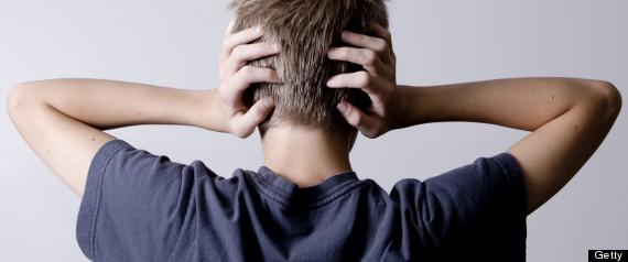 TEENAGER HANDS OVER EARS