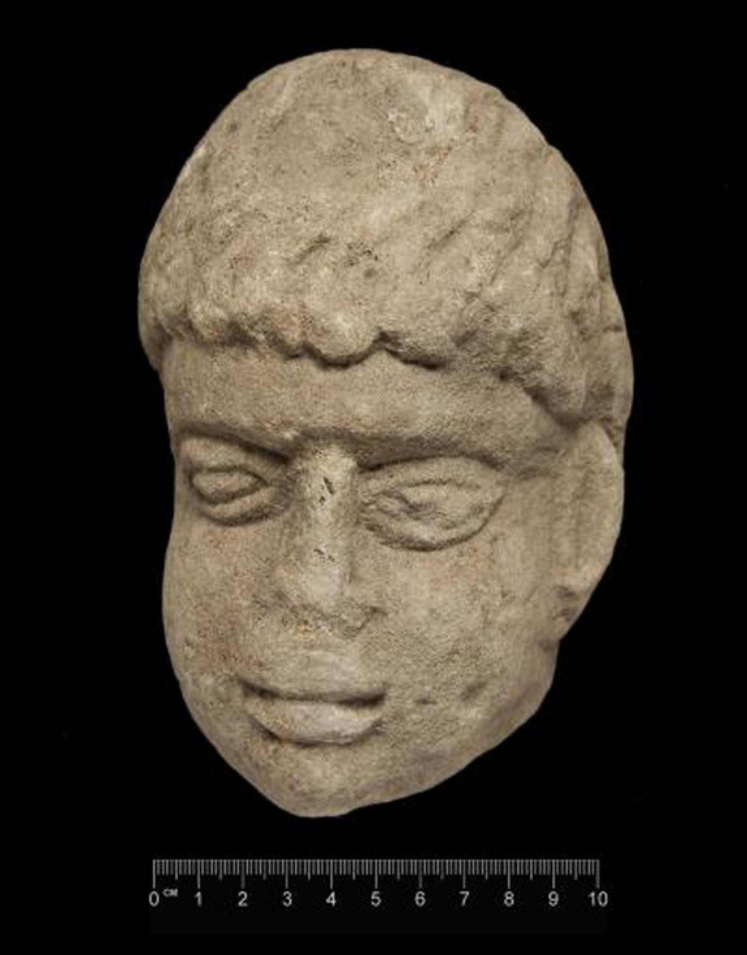 Ancient carving of roman god s head discovered in english