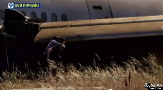 asiana flight attendant carries passengers