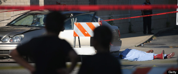chicago police investigate a shooting death on july 11 2013 in chicago