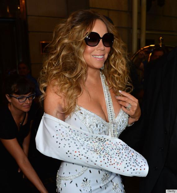 Mariah carey 39 s sling bling glams up singer 39 s arm injury photos poll huffpost - Mariah carey diva ...