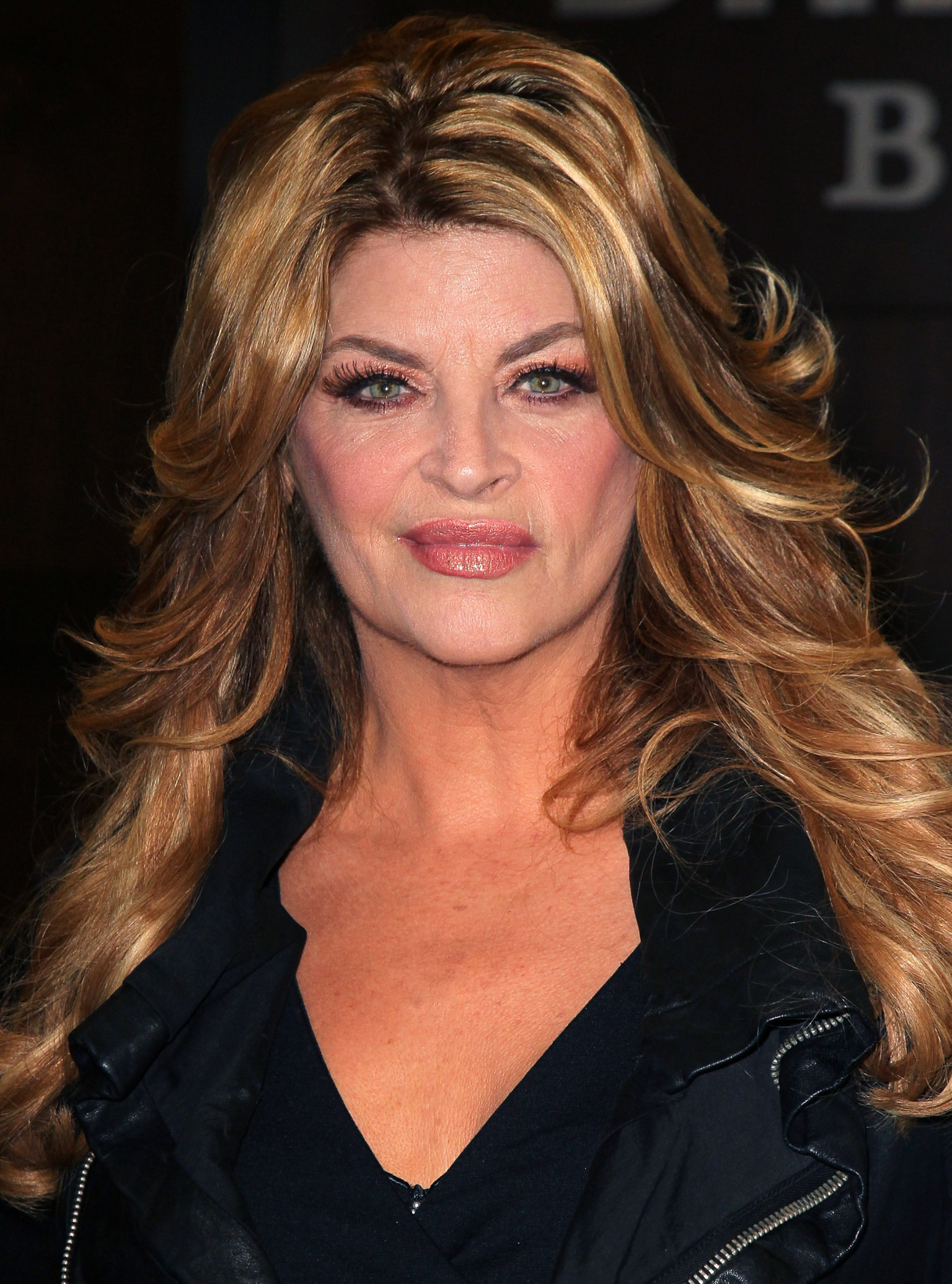 The 66-year old daughter of father Robert Deal Alley and mother Lillian Mickie, 171 cm tall Kirstie Alley in 2017 photo