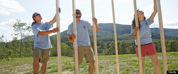 volunteers building a home