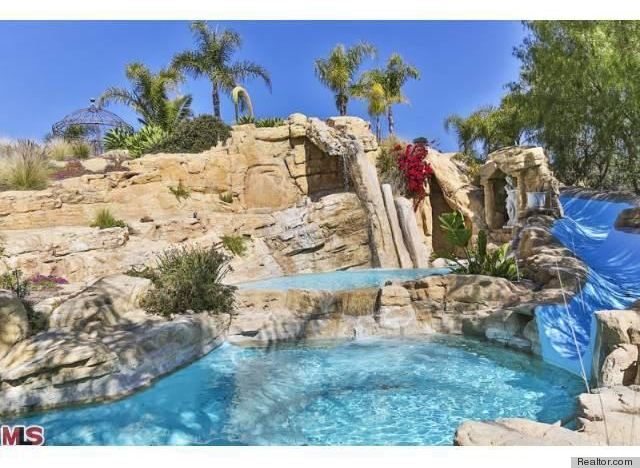 6 epic water slides that make a lavish swimming pool even for Big garden pools