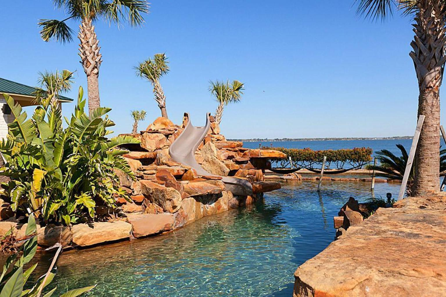 Inground Pools With Waterslides 6 epic water slides that make a lavish swimming pool even better