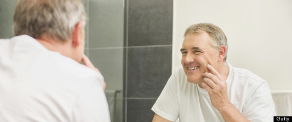 MATURE LOOKING IN MIRROR