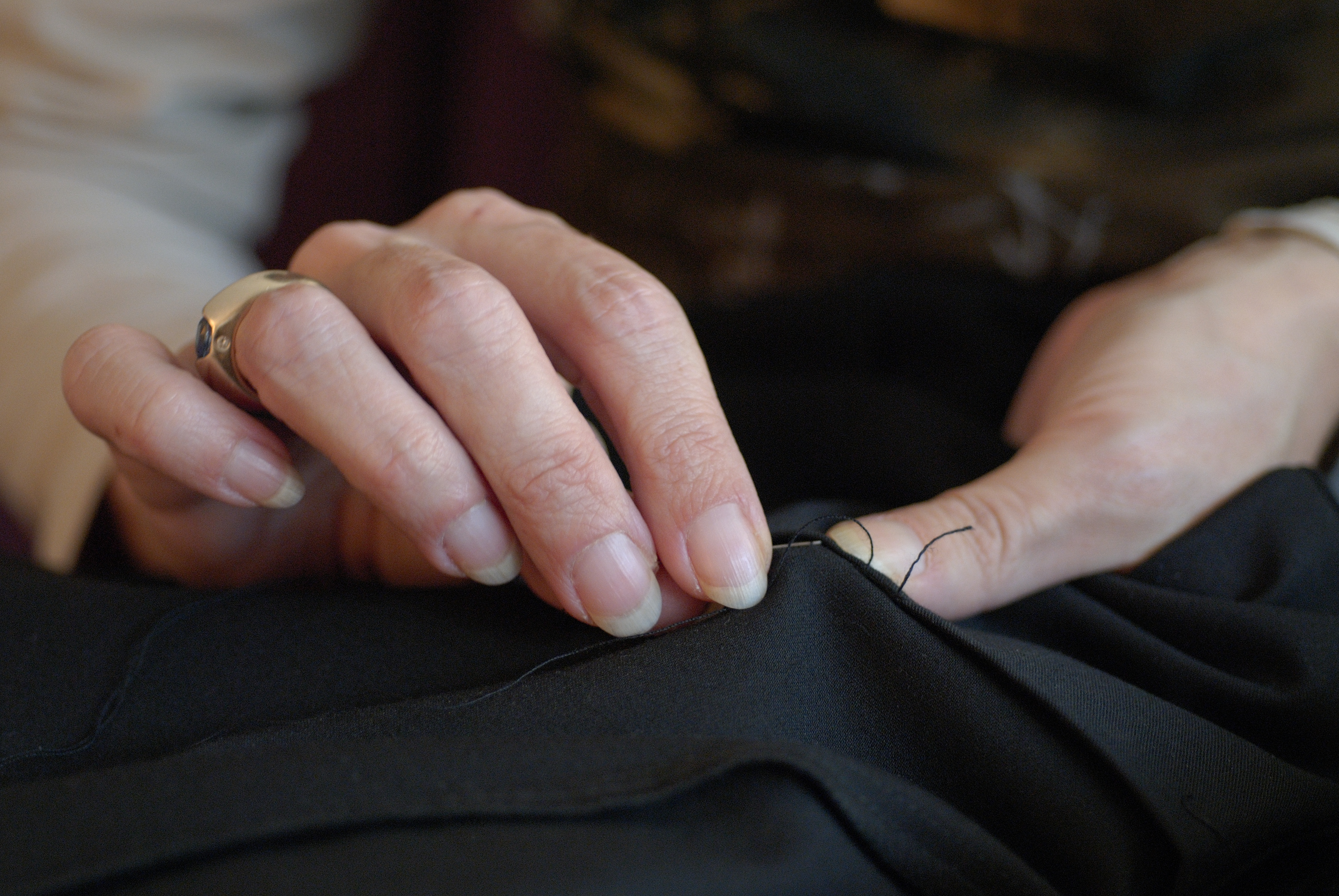 mature woman sewing