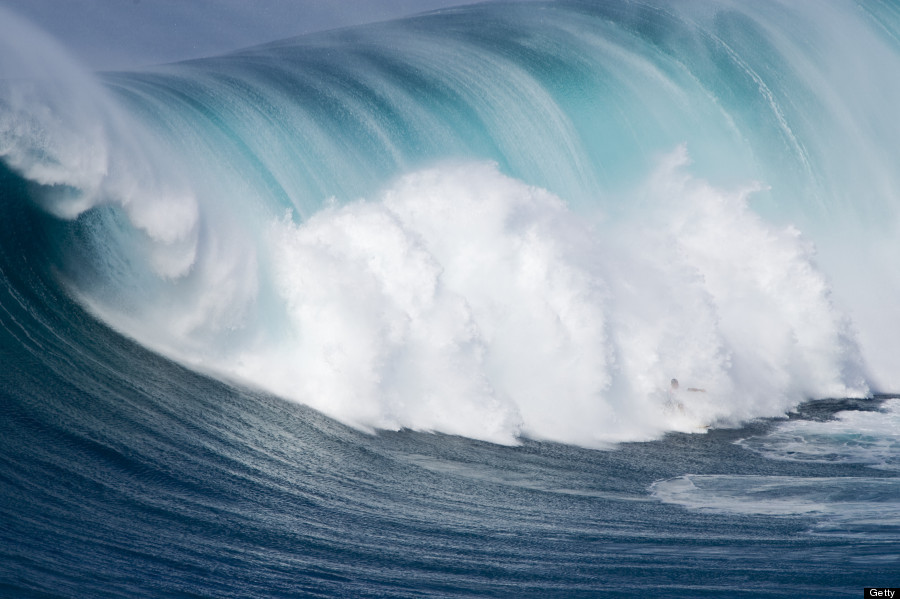 stunning visuals of surfers owning hawaiis most dangerous