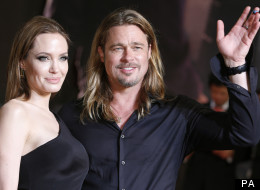 WATCH: Brad Pitt Has Something To Smile About