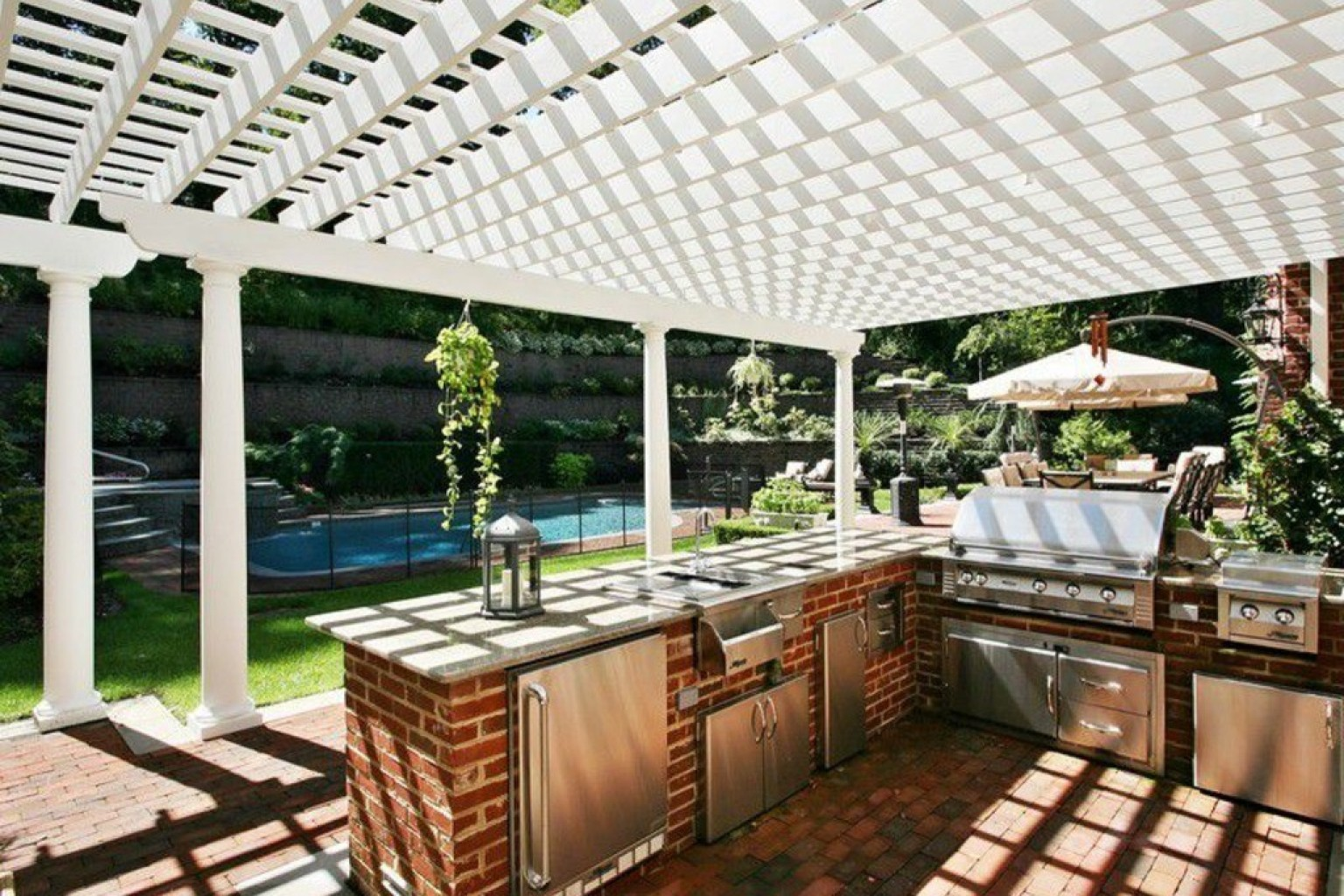 14 incredible outdoor kitchens that go way beyond grills for Backyard kitchen design ideas