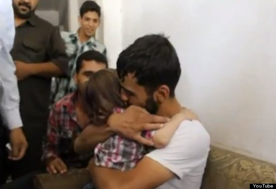 syrian father reunites with son