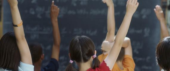 RAISING HAND IN CLASSROOM