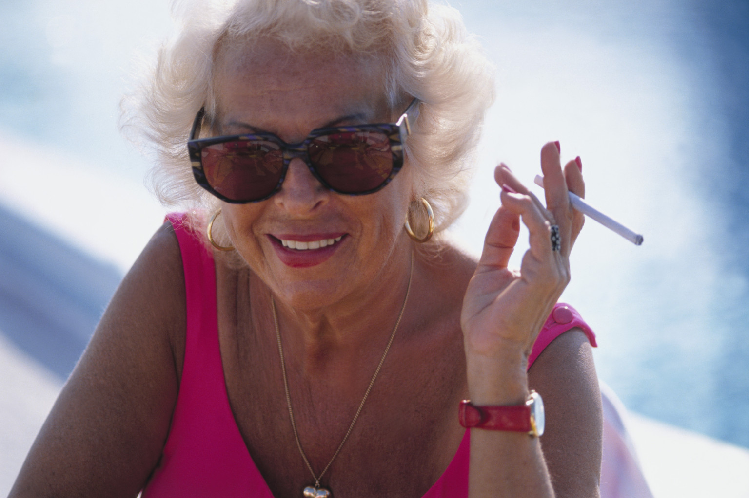 Old women smoking cigarettes