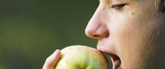 TEEN EATING FRUIT