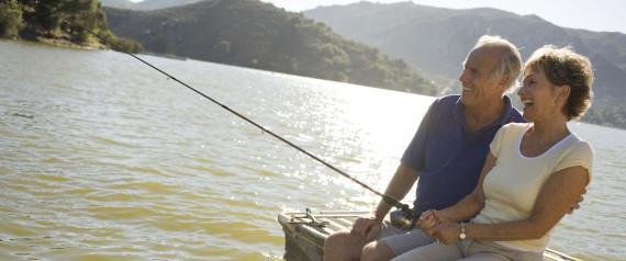 OLDER COUPLE FISHING IN LAKE