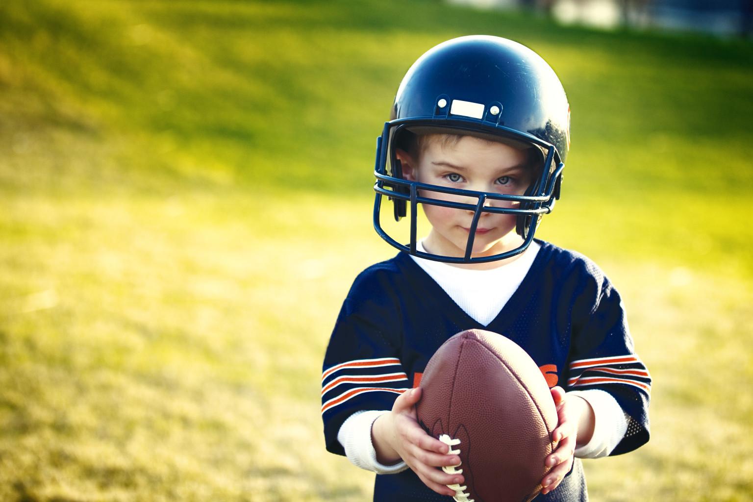 Little boys playing american football