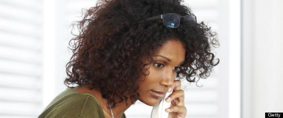 woman talking phone home computer
