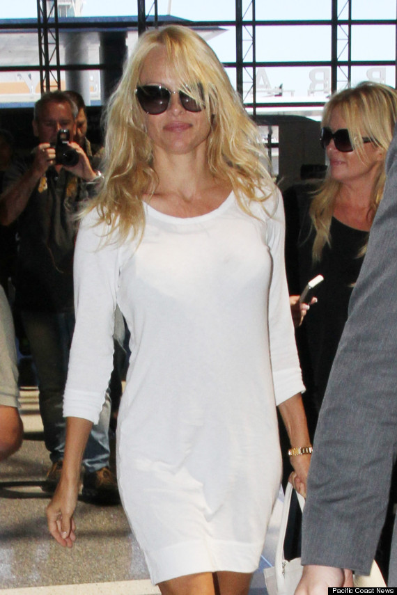 Pamela Anderson Dons White Dress, Flats At LAX Airport | HuffPost
