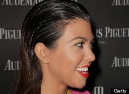 LOOK: Kourtney's All Wet -- And There's Something Really Off