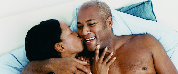 MATURE AFRICAN AMERICAN COUPLE IN BED