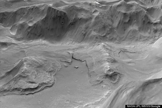 Supervolcanes en antiguas Marte pudo haber rasgado cráteres en la superficie del planeta rojo (VIDEO, FOTOS) O-MARS-SUPERVOLCANO-570