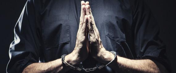 CLERGY HANDCUFFED